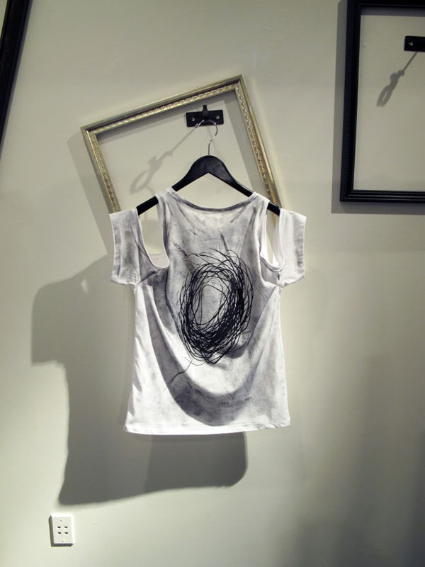 Image of exposed shoulder printed shirt by Shin Pop-Up Shop at Acrimony