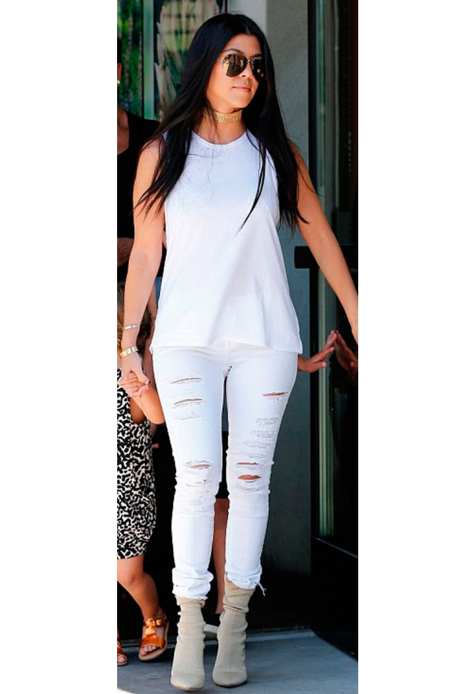 Kourtney Kardashian wearing Frame Denim Le Color Ripped Jean