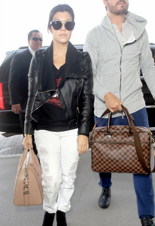 Kourtney Kardashian wearing Lauren Moshi Jet Biting Lip Pullover with Contrast Sleeve