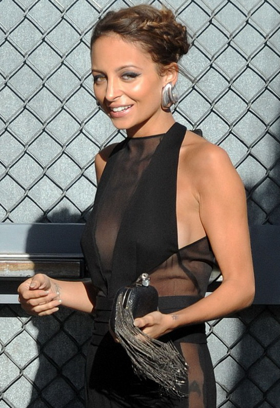 Nicole Richie wearing House of Harlow 1960 Jude Snake Clutch with Gunmetal Fringe