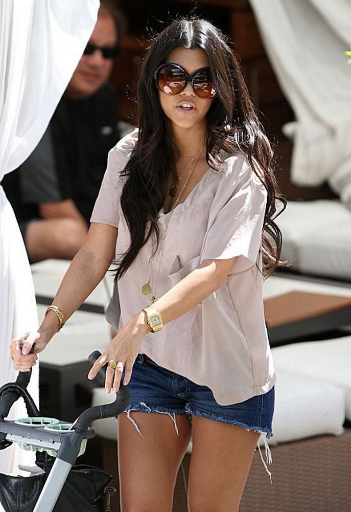 Kourtney Kardashian wearing Siwy Camilla Cut Off Denim Shorts in Wonder