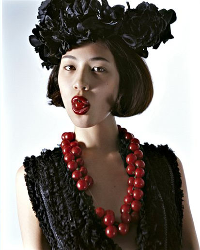 image of Kiko Mizuhara with fruit in the NYC Store's Holiday Campaign
