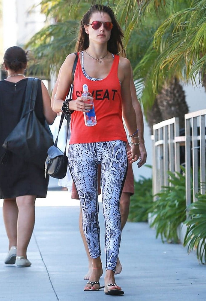 Alessandra Ambrosio wearing hpe Snake Leggings